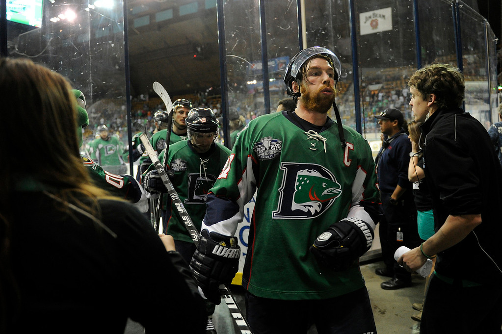 . DENVER, CO - MAY 2: Aaron MacKenzie (37) of the Denver Cutthroats is congratulated by the Cutthroats staff after defeating the Allen Americans 5-4 in game 1 of the Ray Miron Presidents Cup Finals at the Denver Coliseum in Denver, Colorado on May 2, 2014. (Photo by Seth McConnell/The Denver Post)