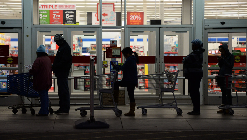. People gather in the pre-dawn hours to be the first inside Kmart for their 6am opening Thursday, November 28, 2013, in Carson, CA. Photo by Steve McCrank/DailyBreeze