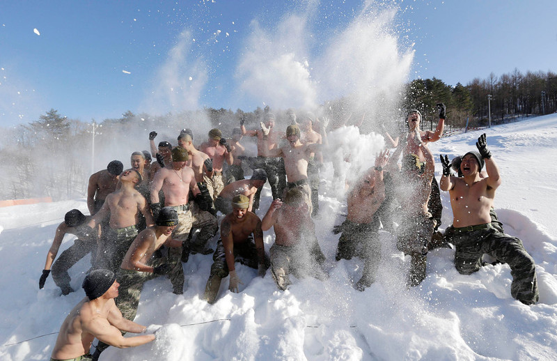 . South Korean Marines and U.S. counterparts from 3-Marine Expeditionary Force 1st Battalion from Kaneho Bay, Hawaii, throw snow to one another during their joint military winter exercise in Pyeongchang, east of Seoul, South Korea, Thursday, Feb. 7, 2013. More than 400 marines from the two countries participated in the Feb. 4-22 joint winter exercise held for the first time in South Korea. (AP Photo/Lee Jin-man)