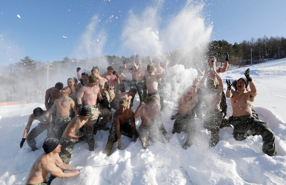 Description of . South Korean Marines and U.S. counterparts from 3-Marine Expeditionary Force 1st Battalion from Kaneho Bay, Hawaii, throw snow to one another during their joint military winter exercise in Pyeongchang, east of Seoul, South Korea, Thursday, Feb. 7, 2013. More than 400 marines from the two countries participated in the Feb. 4-22 joint winter exercise held for the first time in South Korea. (AP Photo/Lee Jin-man)