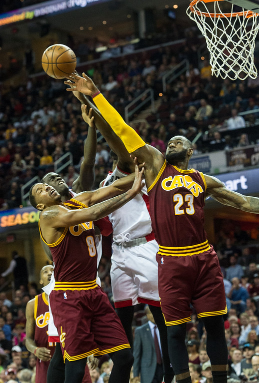 . Cleveland Cavaliers\' LeBron James (23) and Cleveland Cavaliers\' Channing Frye (8) gofer a rebound against the Toronto Raptors during the first half of an NBA basketball game in Cleveland, Tuesday, Nov. 15, 2016. (AP Photo/Phil Long)