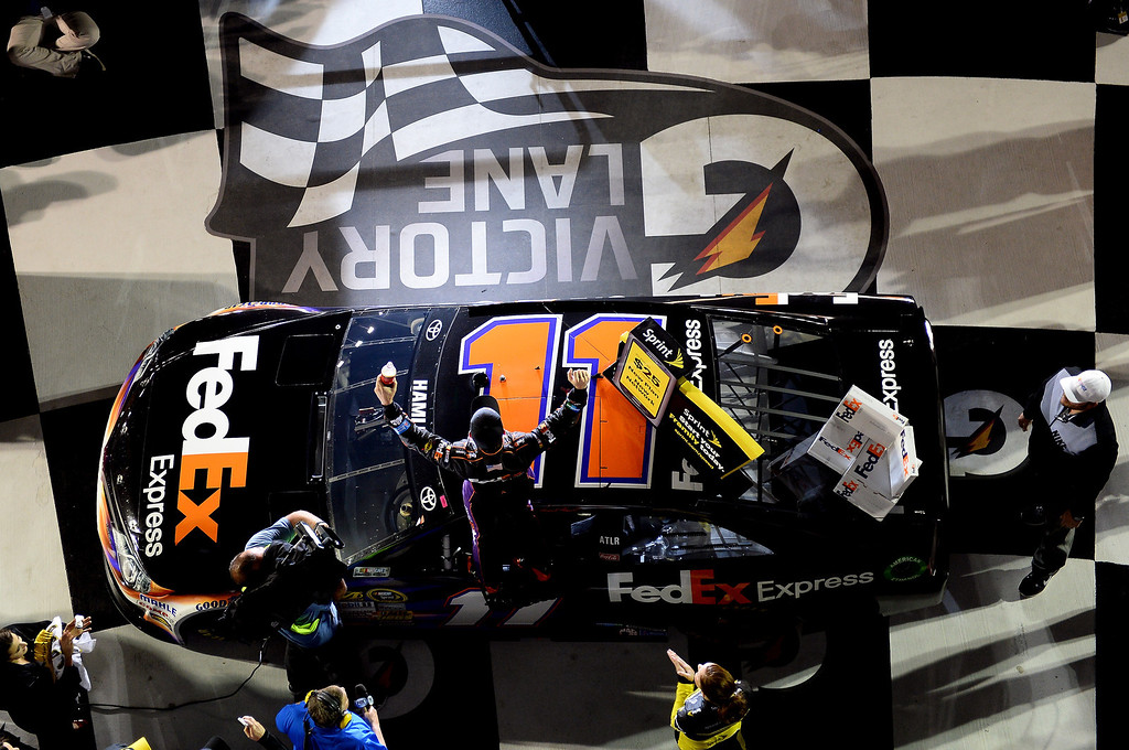 . Denny Hamlin, driver of the #11 FedEx Express Toyota, celebrates in Victory Lane after winning during the NASCAR Sprint Cup Series Budweiser Duel 2 at Daytona International Speedway on February 20, 2014 in Daytona Beach, Florida.  (Photo by Jared C. Tilton/Getty Images)