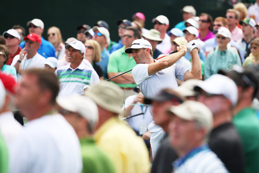 . Dustin Johnson of the United States tees off on the eighth hole during the second round of the 2013 Masters Tournament at Augusta National Golf Club on April 12, 2013 in Augusta, Georgia.  (Photo by Mike Ehrmann/Getty Images)