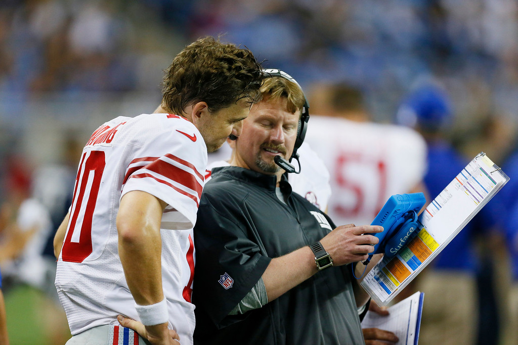 . New York Giants quarterback Eli Manning talks with offensive coordinator Ben Mcadoo during the second quarter of an NFL football game against the Detroit Lions in Detroit, Monday, Sept. 8, 2014. (AP Photo/Paul Sancya)
