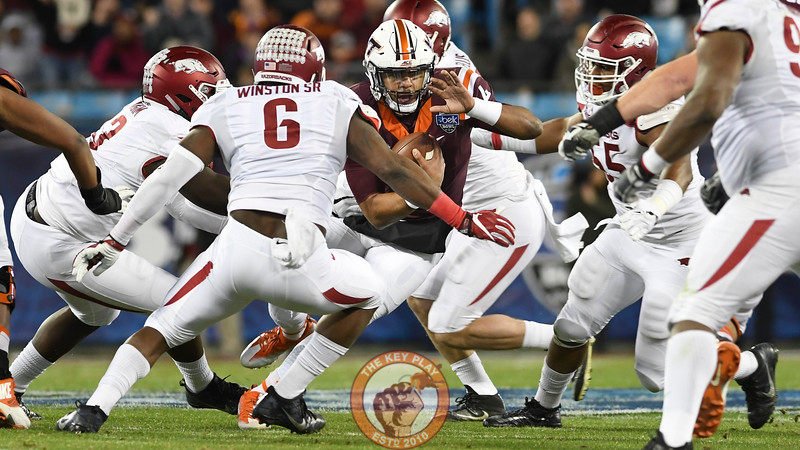 Virginia Tech quarterback Jerod Evans (4) is surrounded and brought down by Arkansas defenders early in the game. (Michael Shroyer/ TheKeyPlay.com)