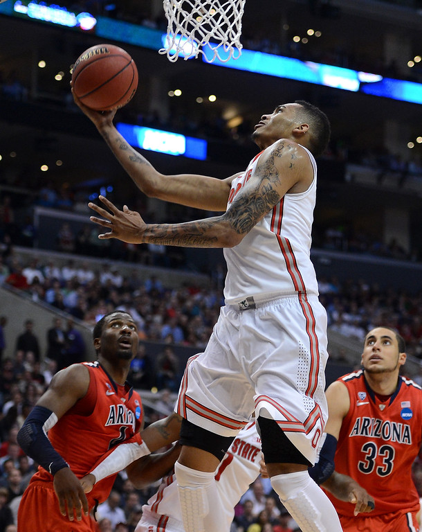 . LaQuinton Ross #10 of the Ohio State Buckeyes goes up for a shot between Solomon Hill #44 and Grant Jerrett #33 of the Arizona Wildcats in the second half during the West Regional of the 2013 NCAA Men\'s Basketball Tournament at Staples Center on March 28, 2013 in Los Angeles, California.  (Photo by Harry How/Getty Images)