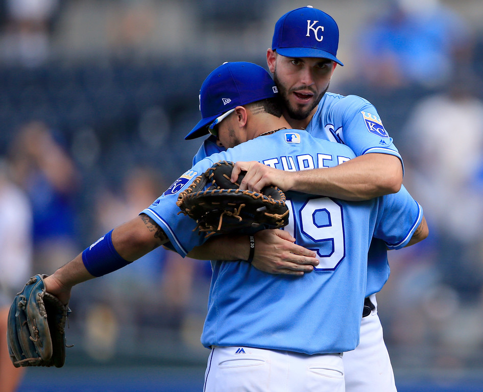 . Kansas City Royals third baseman Cheslor Cuthbert (19) and first baseman Eric Hosmer (35) hug following a baseball game against the Cleveland Indians at Kauffman Stadium in Kansas City, Mo., Sunday, Aug. 20, 2017. The Royals defeated the Indians 7-4. (AP Photo/Orlin Wagner)