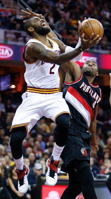 . Cleveland Cavaliers\' Kyrie Irving (2) shoots against Portland Trail Blazers\' Maurice Harkless (4) during the first half of an NBA basketball game Wednesday, Nov. 23, 2016, in Cleveland. (AP Photo/Ron Schwane)