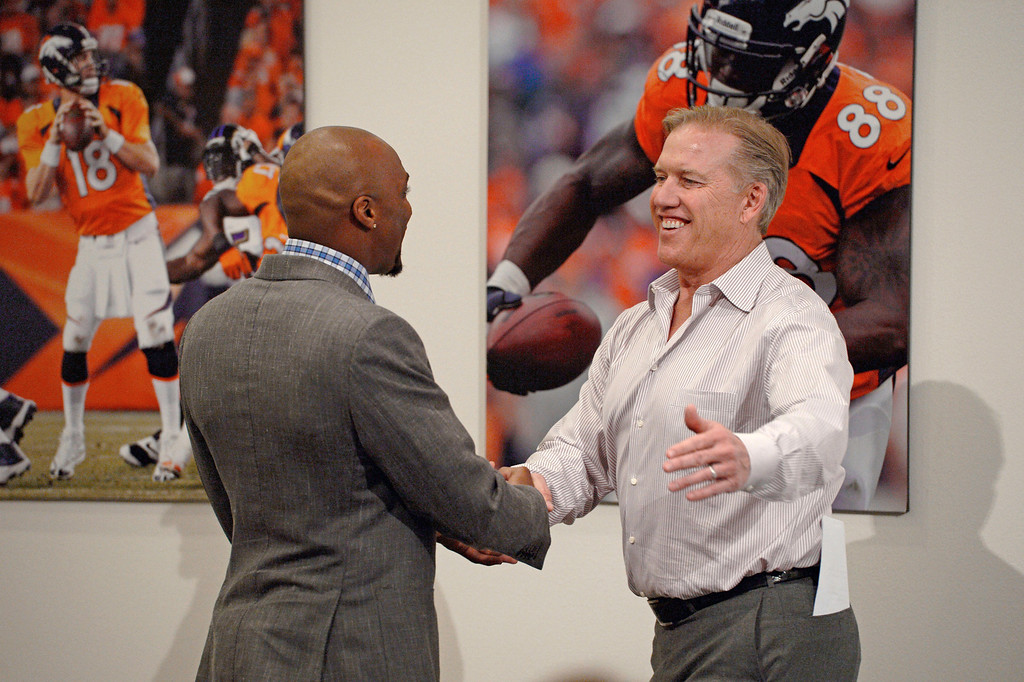 . Denver Broncos John Elway, General Manager Executive Vice President Football Operations shakes hands with Aqib Talib March 12, 2014 at Dove Valley. (Photo by John Leyba/The Denver Post)