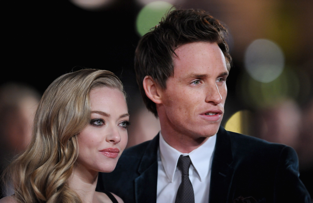 ". Actors Amanda Seyfried and Eddie Redmayne attend the ""Les Miserables\"" World Premiere at the Odeon Leicester Square on December 5, 2012 in London, England.  (Photo by Stuart Wilson/Getty Images)"