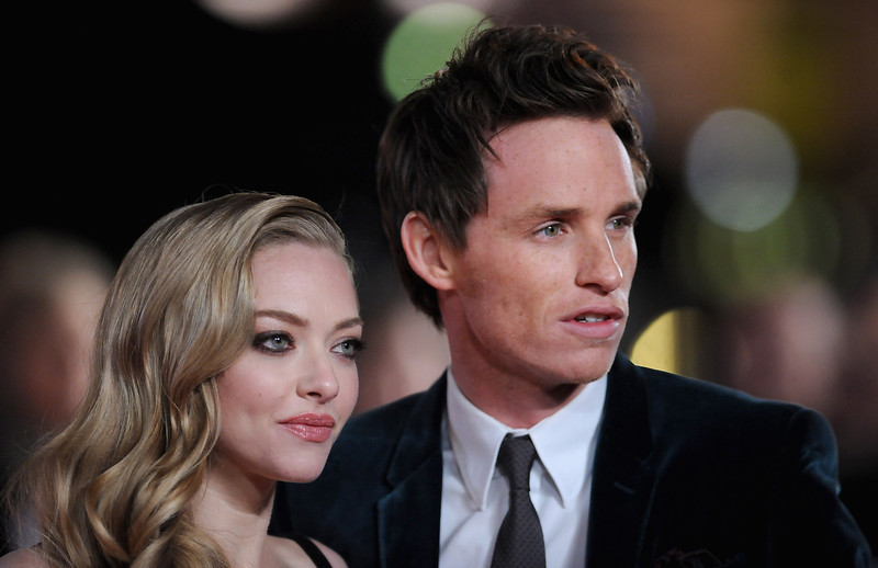 """. Actors Amanda Seyfried and Eddie Redmayne attend the \""""Les Miserables\"""" World Premiere at the Odeon Leicester Square on December 5, 2012 in London, England.  (Photo by Stuart Wilson/Getty Images)"""
