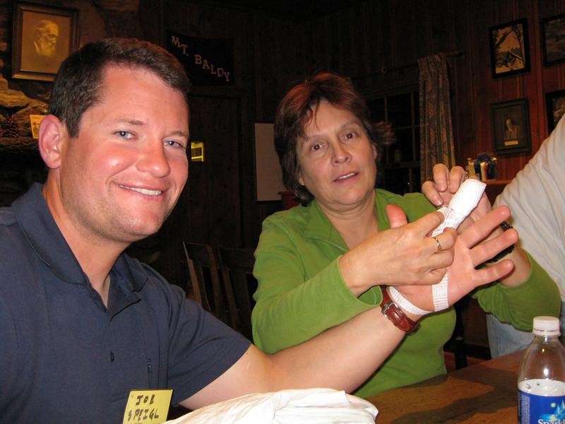 Joseph too. Dora finishing finger bandage.
