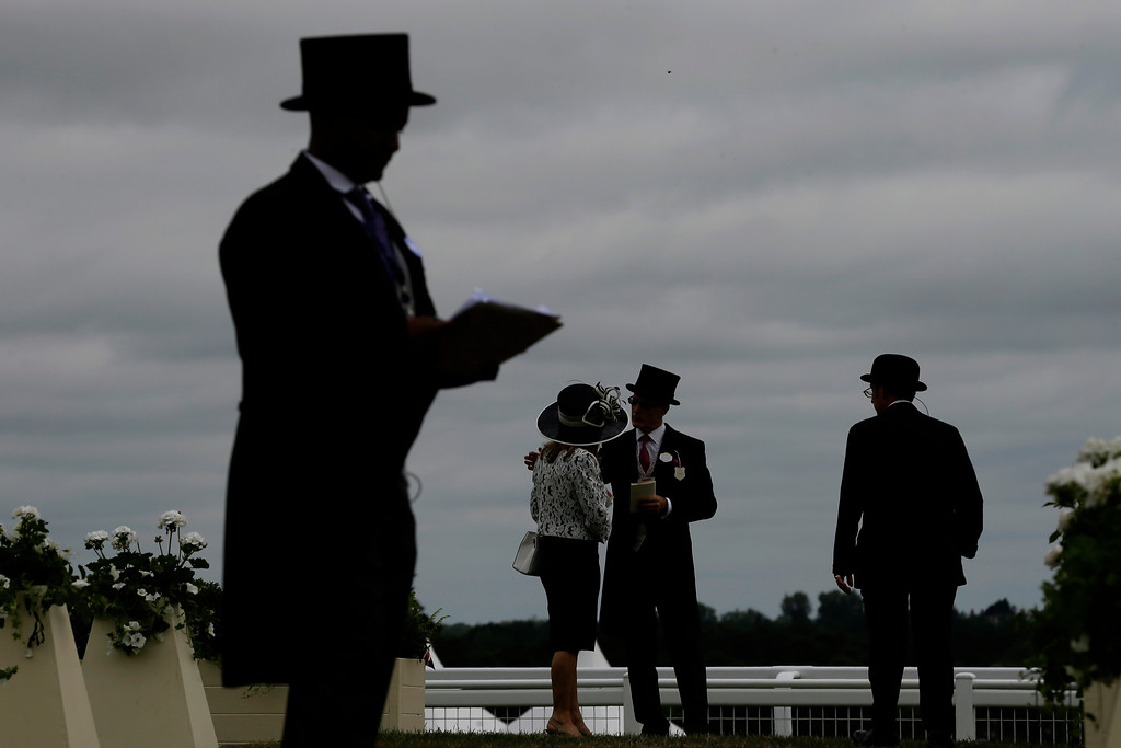 . Event visitors arrive at the Royal Ascot horse race meeting in Ascot, England, Wednesday, June 20, 2018. (AP Photo/Tim Ireland)