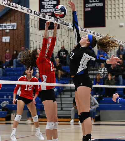 11/7/2019 Mike Orazzi | StaffrBristol Eastern's Hannah Webber (22) and Conard High School's Isabella Pincince (15) during the CCC girls volleyball tournament at Avon High School on Thursday. r