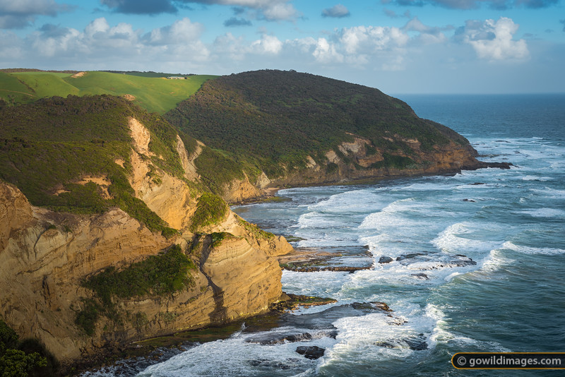 A farm house perched above the rugged coastline and Bass Strait. View from The Gable, Moonlight Head, Great Otway NP.