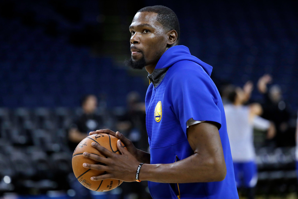 . Golden State Warriors\' Kevin Durant prepares to shoot during an NBA basketball practice, Wednesday, May 31, 2017, in Oakland, Calif. The Golden State Warriors face the Cleveland Cavaliers in Game 1 of the NBA Finals on Thursday in Oakland. (AP Photo/Marcio Jose Sanchez)