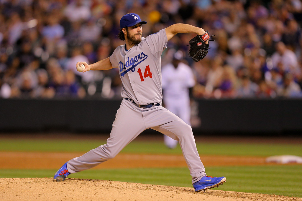 . DENVER, CO - SEPTEMBER 16:  Starting pitcher Dan Haren #14 of the Los Angeles Dodgers delivers to home plate during the third inning against the Colorado Rockies at Coors Field on September 16, 2014 in Denver, Colorado. (Photo by Justin Edmonds/Getty Images)