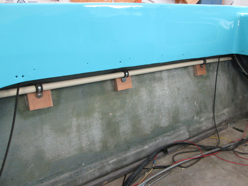 Plastic tub for wires mounted to the port side.