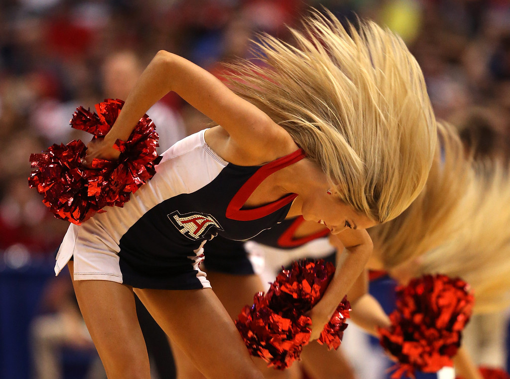 . An Arizona Wildcats cheerleader performs as the Wildcats take on the Wisconsin Badgers during the West Regional Final of the 2014 NCAA Men\'s Basketball Tournament at the Honda Center on March 29, 2014 in Anaheim, California.  (Photo by Jeff Gross/Getty Images)