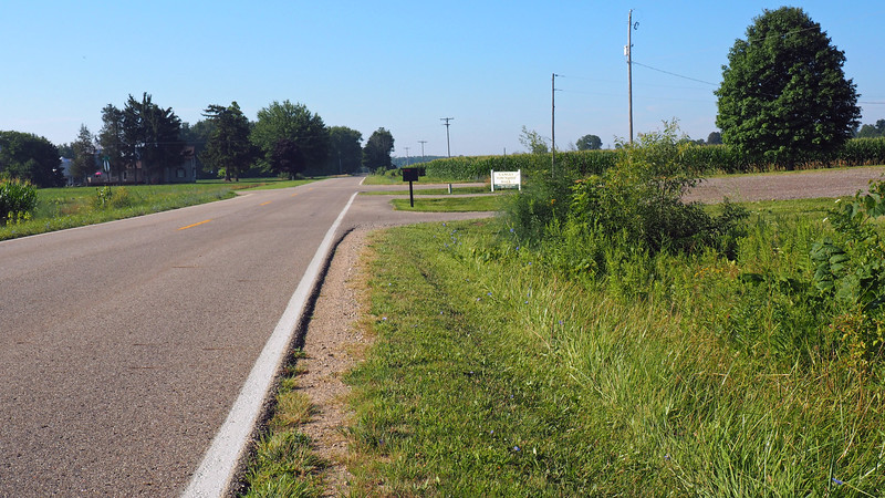 Looking south past the driveway entrance to Ganges Township Hall