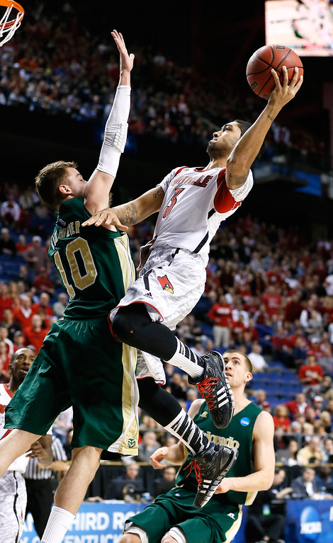 . LEXINGTON, KY - MARCH 23: Peyton Siva #3 of the Louisville Cardinals drives to the basket against Wes Eikmeier #10 of the Colorado State Rams in the first half during the third round of the 2013 NCAA Men\'s Basketball Tournament at Rupp Arena on March 23, 2013 in Lexington, Kentucky.  (Photo by Kevin C. Cox/Getty Images)