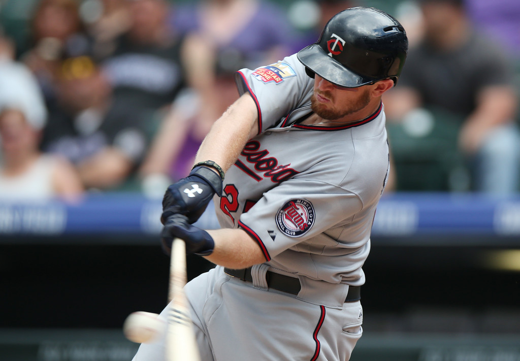 . Minnesota Twins\' Chris Parmelee fouls off a pitch against the Colorado Rockies to end the top of the eighth inning. (AP Photo/David Zalubowski)