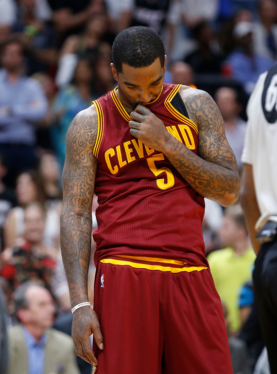 . Cleveland Cavaliers guard JR Smith pauses after a play during the second half of an NBA basketball game against the Miami Heat, Monday, April 10, 2017, in Miami. The Heat defeated the Cavaliers 124-121 in overtime. (AP Photo/Wilfredo Lee)