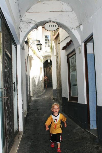 TRAVEL italy boy running old city.JPG