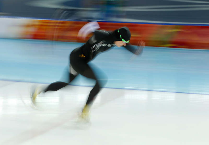 . Lauren Cholewinski of the U.S. takes the start in the first heat of the women\'s 500-meter speed skating race at the Adler Arena Skating Center during the 2014 Winter Olympics, Tuesday, Feb. 11, 2014, in Sochi, Russia. (AP Photo/Pavel Golovkin)