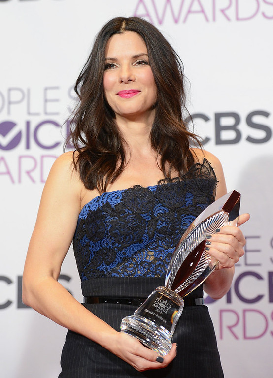 . Actress Sandra Bullock, winner of Favorite Humanitarian award, poses in the press room at the 39th Annual People\'s Choice Awards at Nokia Theatre L.A. Live on January 9, 2013 in Los Angeles, California.  (Photo by Jason Merritt/Getty Images)
