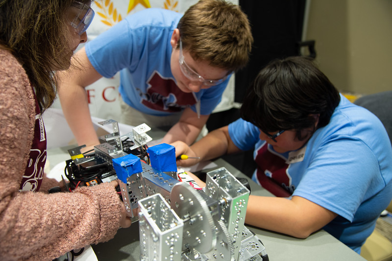 Team Ranger Robotics adjust their wheels before the competition.
