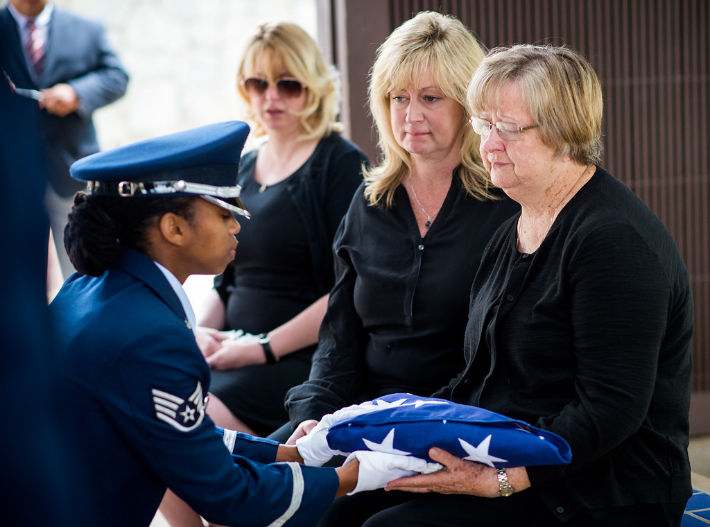 . Brittarose Morgan, 77, wife of the late Airman First Class Roland Morgan receives the U.S. flag from Staff Sgt. Zakia Webster of the Blue Eagles Honor Guard at Riverside National Cemetery in Riverside, Calif. on Tuesday, May 19, 2015. (Photo by Watchara Phomicinda/ Los Angeles Daily News)