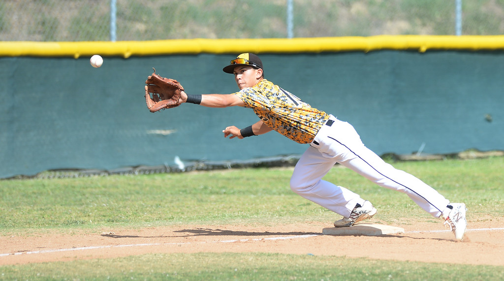 . Santa Fe third baseman Viktor Arreola (#10) dives for a wide throw at third base as they play La Serna in their Del Rio League game at La Serna High School in Whittier on Wednesday April 23, 2014. (Staff Photo by Keith Durflinger/Whittier Daily News)