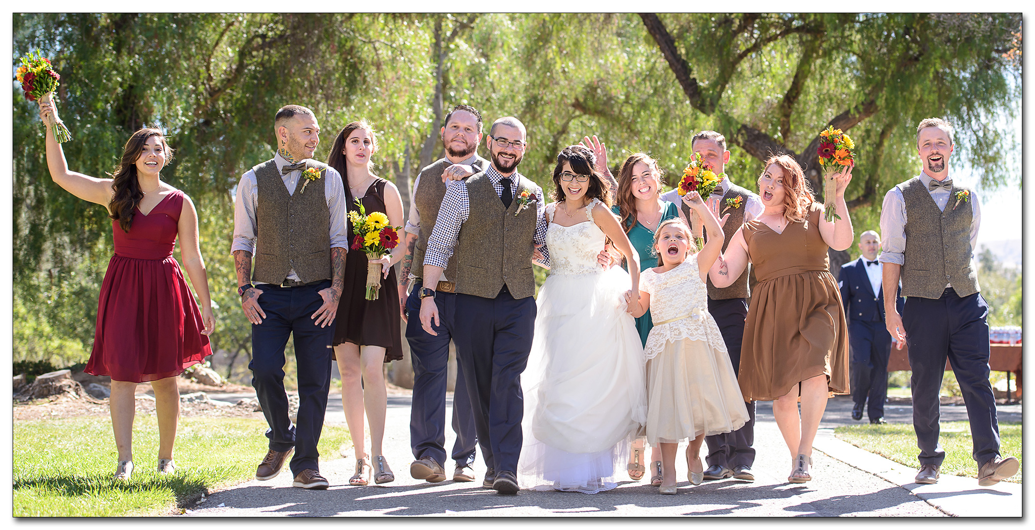 bridal party walking in Ravenswood Historic Site in Livermore
