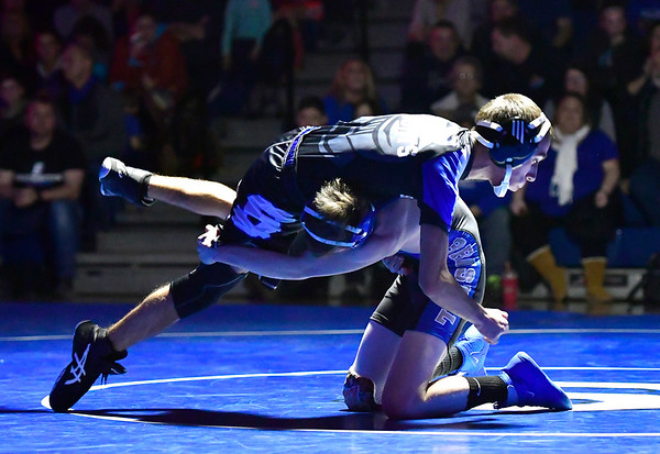 12/12/2018 Mike Orazzi | Staff Bristol Eastern's Trent Thompson and Southington's Anthony Del Debbio in the 106 match at Southington High School Wednesday night.