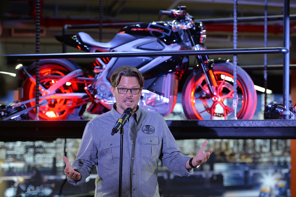 . Harley-Davidson chief marketing officer Mark-Hans Richer, speaks in front of a Project LiveWire motorcycle, the company\'s first electric motorcycle, during a preview June 23, 2014 at a Harley-Davidson dealer in New York. AFP PHOTO/Stan HONDA/AFP/Getty Images