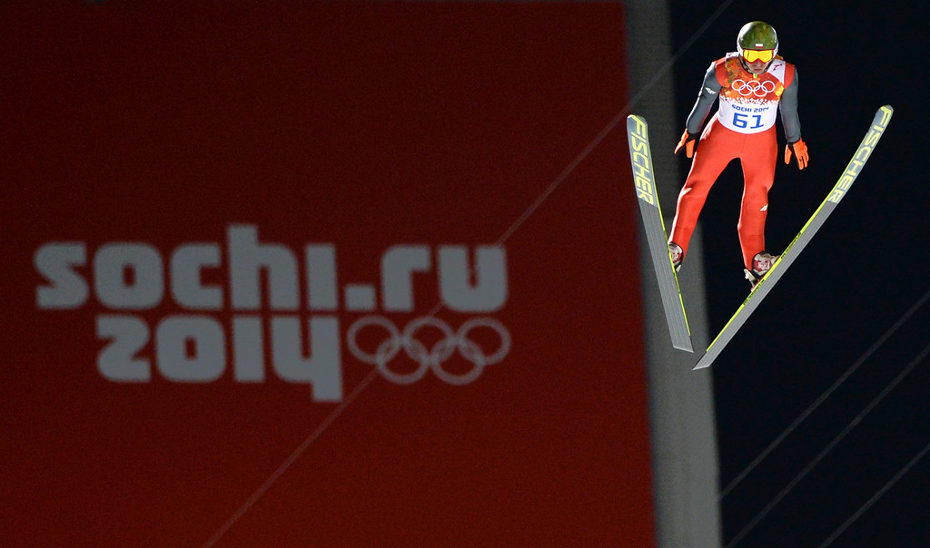 . Poland\'s Kamil Stoch competes during the trial jump of the Men\'s Ski Jumping Large Hill Individual qualification at the RusSki Gorki Jumping Center during the Sochi Winter Olympics on February 14, 2014 in Rosa Khutor near Sochi.  AFP PHOTO / PETER PARKS/AFP/Getty Images