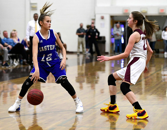 1/17/2019 Mike Orazzi | Staff Bristol Eastern's CaliRose Doyon (12) and Bristol Central's Ella Watson (23) during Thursday night's girls basketball game with Bristol Central at BC.