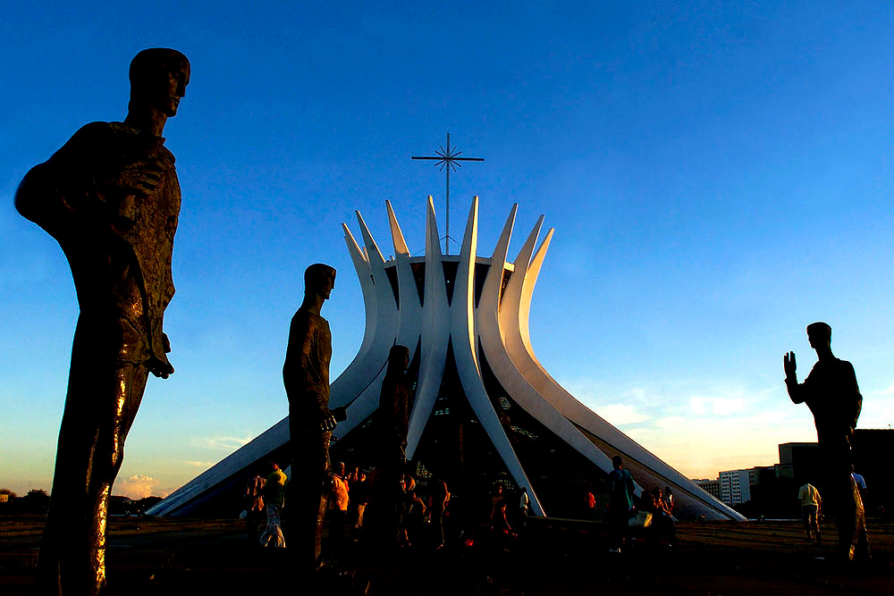 Description of . The statues of the apostles are seen in front of the Cathedral of Brasilia, an architectural landmark created by architect Oscar Niemeyer, in Brasilia, Brazil.  According to a hospital spokeswoman on Wednesday, Dec. 5, 2012, famed Brazilian architect Oscar Niemeyer has died at age 104.  (AP Photo/Eraldo Peres)