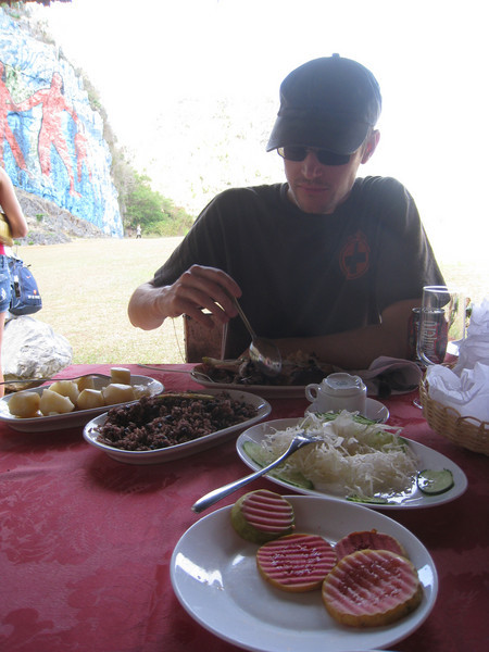 Roast pork dinner with guava, boiled potatoes, rice and beans, and cabbage at the Mural de la Prehistoria.