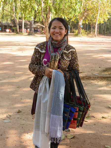 A young woman selling scarves -- worn by many Cambodians -- at the temple Bakong. We purchased several from her for about $3 each.