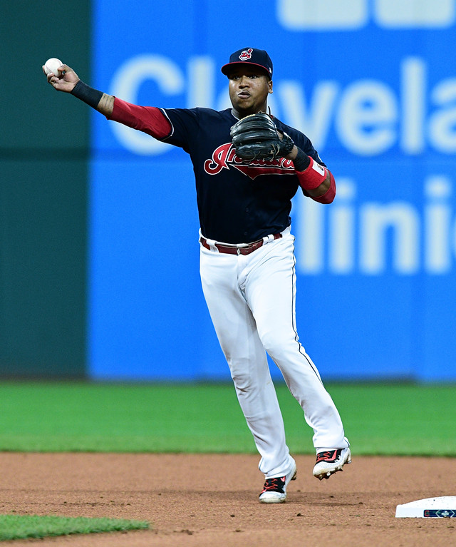 . Cleveland Indians\' Jose Ramirez throws out New York Yankees\' Starlin Castro at first base in the second inning of Game 5 of baseball\'s American League Division Series, Wednesday, Oct. 11, 2017, in Cleveland. (AP Photo/David Dermer)