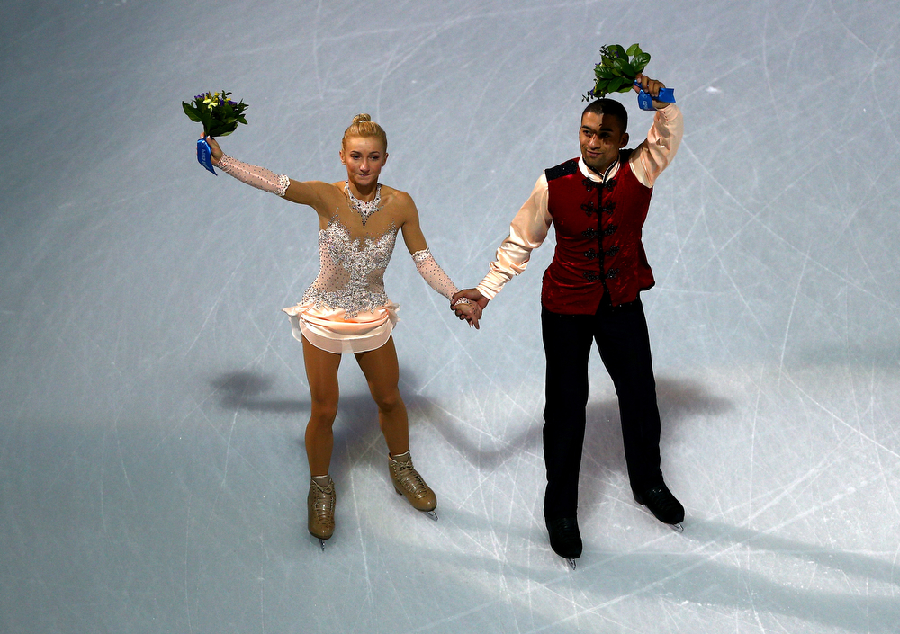 . Bronze medalists Aliona Savchenko and Robin Szolkowy of Germany  wave to fans after the flower ceremony for the Figure Skating Pairs event during day five of the 2014 Sochi Olympics at Iceberg Skating Palace on February 12, 2014 in Sochi, Russia.  (Photo by Clive Mason/Getty Images)