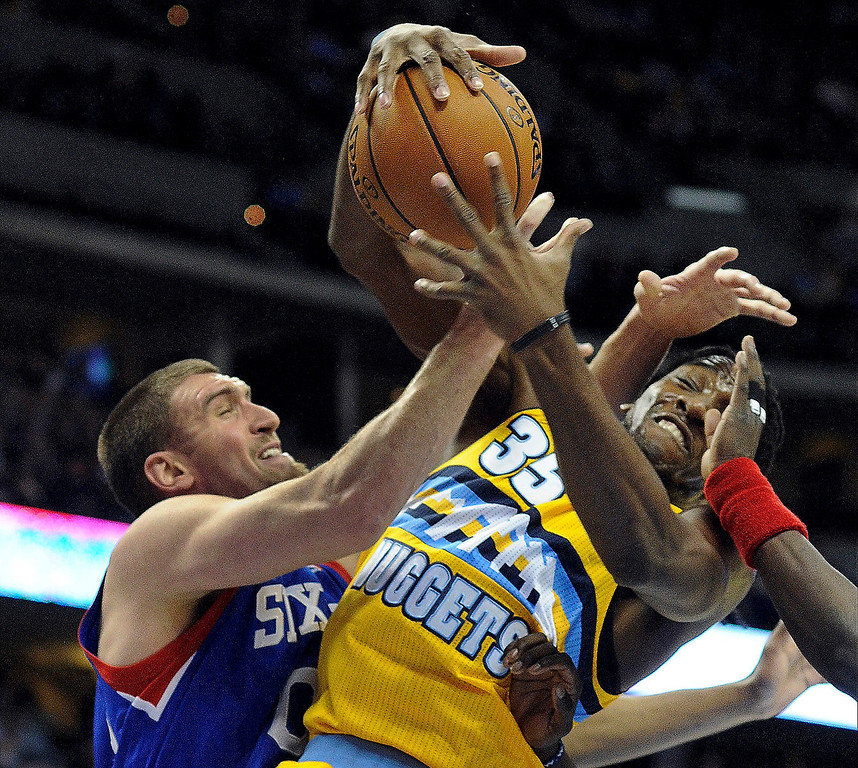 . DENVER, CO. - MARCH 21: Kenneth Faried (35) of the Denver Nuggets fights for a rebound with Spencer Hawes (00) of the Philadelphia 76ers in the first half. The Denver Nuggets hosted the Philadelphia 76ers Thursday night, March 21, 2013 at the Pepsi Center. (Photo By Karl Gehring/The Denver Post)