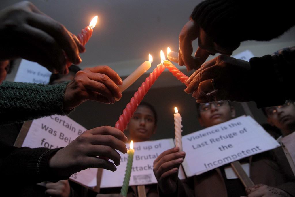 . Indian schoolchildren hold placards and candles as they pay tribute to Pakistan children and staff killed in a Taliban attack on a school in Peshawar, at a school in Amritsar on December 17, 2014.  Pakistan began three days of mourning on December 17 for the 132 schoolchildren and nine staff killed by the Taliban in the country\'s deadliest ever terror attack as the world united in a chorus of revulsion.    AFP PHOTO/NARINDER NANU/AFP/Getty Images