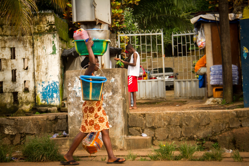 The people of Sierra Leone can carry a lot more on their person than we can.  I've been told that all one needs is a towel to balance the large baskets/buckets balanced on one's head.