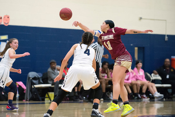 02/13/20 Wesley Bunnell | StaffrrNewington girls basketball defeated New Britain at home Thursday evening. New Britain's Nataly Hernandez (11) reaches to intercept a pass.