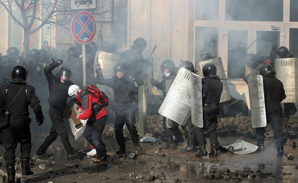 """. Police clash with anti-government protesters in Kiev on February 18, 2014.  Ukraine\'s prosecutor-general on Tuesday warned he would seek to impose the \""""harshest punishment\"""" on those behind an outburst of violence in Kiev. \""""The prosecutor-general will demand the harshest punishments for those who provoked people to carry out today\'s actions, those who organized it and those who directed it,\"""" prosecutor-general Viktor Pshonka said in a statement. AFP PHOTO/ ANATOLII BOIKO/AFP/Getty Images"""