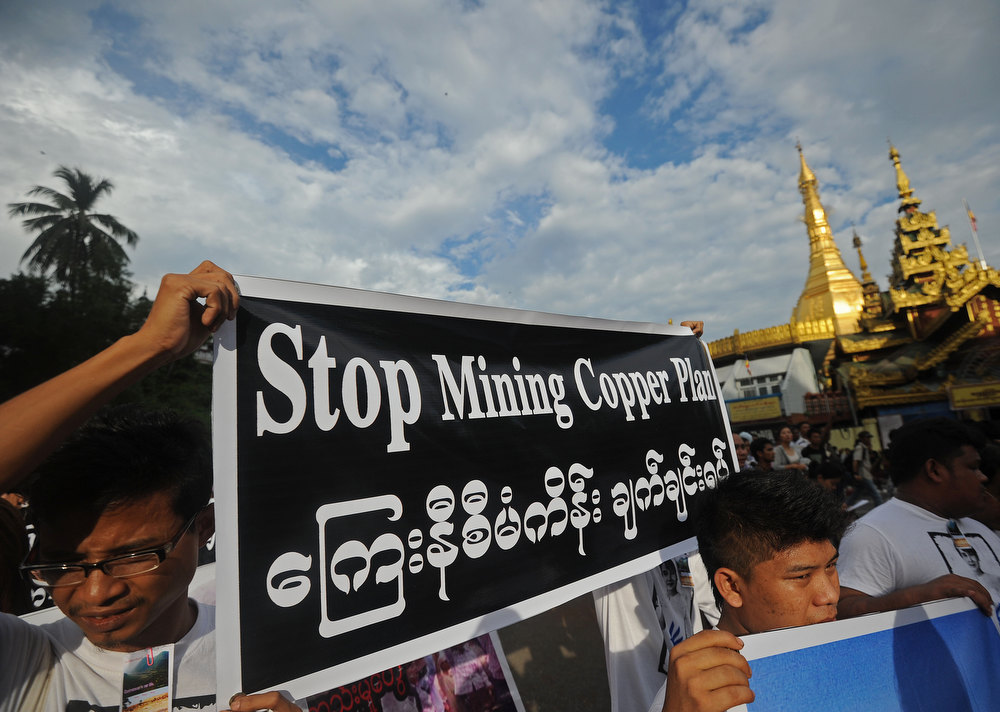 Description of . Protesters hold banners as they protest against Latpadaung copper mining plan in Yangon on November 26, 2012. The copper mine, a joint venture between military-owned Myanmar Economic Holdings and China's Wanbao company, has been the subject of controversy for months after local media allegations of corruption over the project. Soe Than WIN/AFP/Getty Images