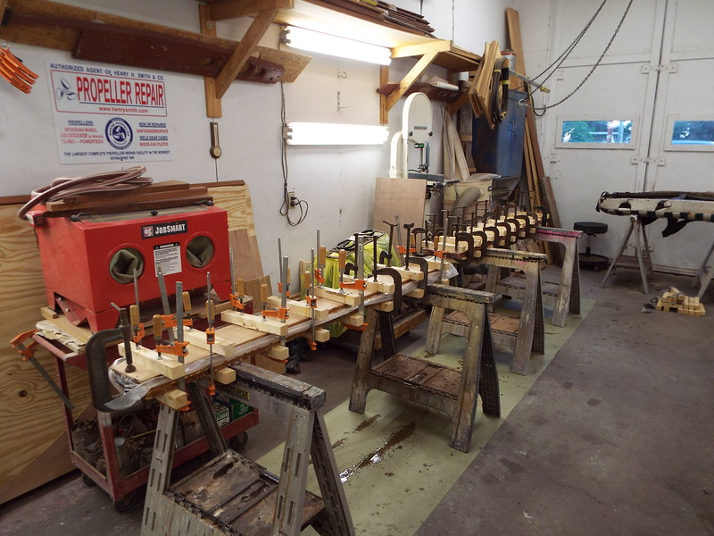 Gluing up wood for new seat frames.